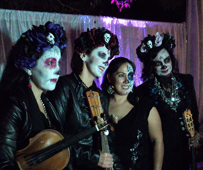 Trio Ellas pose with fans after the concert