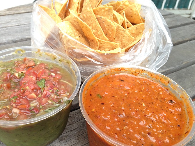 Fresh chips, guacamole, and a tub of Sonia Campos's chipotle salsa