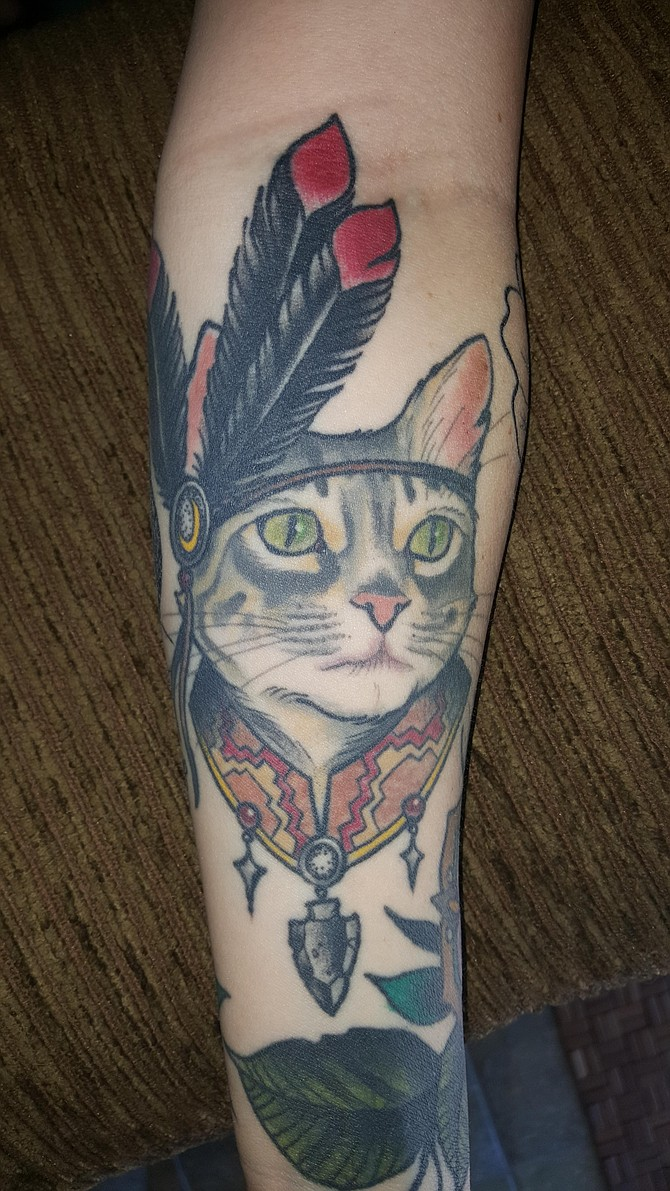 My name is Jennay. I'm 22,  I live in LA Mesa, CA. I work as a front desk associate at massage envy. I got this tattoo at The Grand Reaper in Hillcrest, CA by Chris Primm. Four years ago I rescued my cat Sadie from the Bonita animal shelter.  I really was more excited to get to have a little fur ball running around,  but when we were filling out the paperwork the vet on site came in to tell me how happy she was that I adopted her. Her put down date was the very next day. I couldn't believe my luck and timing. She has been nothing short of a best friend to me since I got her. Three years ago I decided to get this tattoo, yes my little Indian kitty is my favorite  one I have. She has seriously taught me so much and I really wouldn't be the lady I am today without her.
