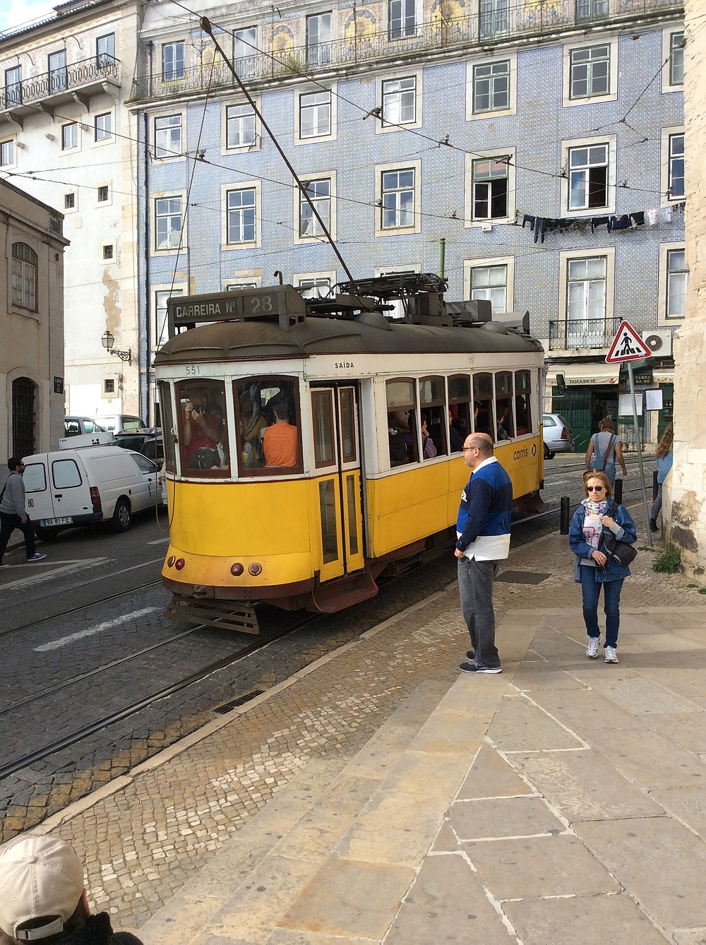 Waiting for the tram in Lisbon.
