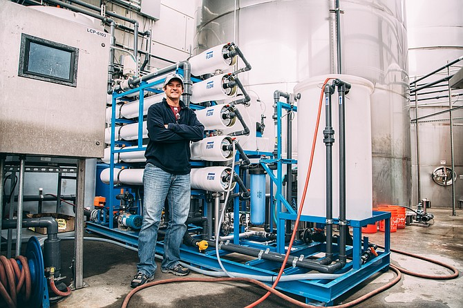 Tim Suydam, Stone Brewing's senior water operations manager, stands before some of the brewery's water-recycling equipment.