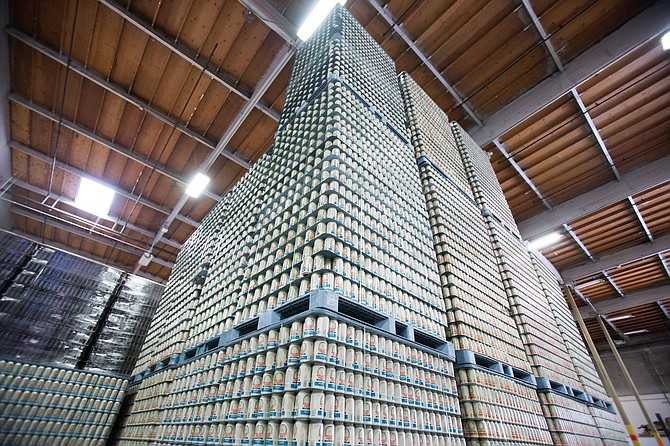 Cans of Ballast Point beer stack high in it's Miramar production facility. The brewery estimates it will sell four million cases this year.  - Image by Andy Boyd