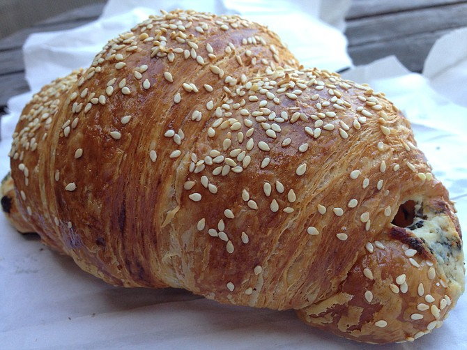 Crispy, flaky, and coated with sesame seeds: the goat cheese with scallions and basil croissant