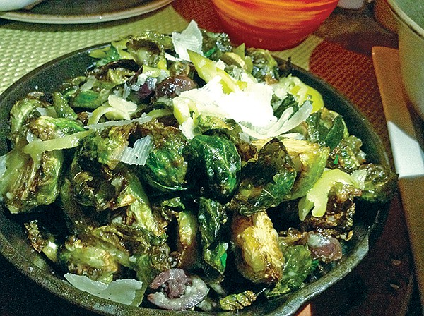 Brussels sprouts and mix in iron skillet. For five bucks.