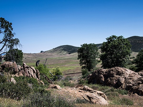 The Soapstone Grade Fire Road has metamorphic boulders and views of the grasslands beyond.