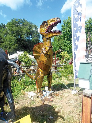 Big metal dinosaur outside Alpine Garden and Gifts