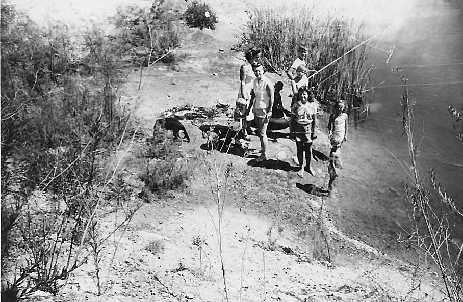 Author with family at Hollister Pond, c. 1950. The western end of the 11-mile-long park is Hollister Pond, where I fished and jumped off rafts.