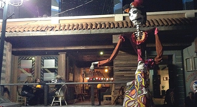 Fifteen-foot-tall Day of the Dead figure guards the entrance to Entremundos