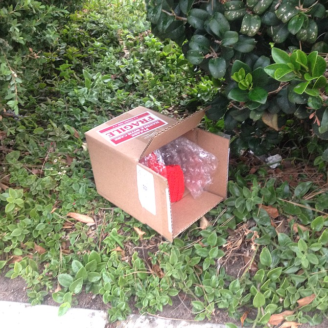 "A neighbor found this box ""with something red that someone had knitted"" and took it to the specified address"