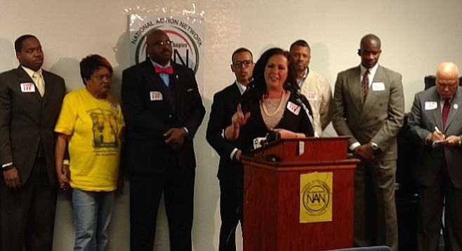 """Lorena Gonzalez (at lectern) thought filing a request to change the name of the school would be a """"no-brainer."""""""