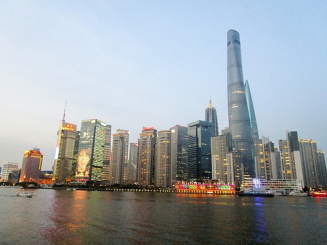Shanghai's skyline starts to come alive at twilight.