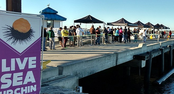 Patrons line up awaiting the opening of Tuna Harbor Dockside Market on December 5, 2015