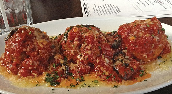 What $5 buys during happy hour: three zesty meatballs of beef, pork, veal