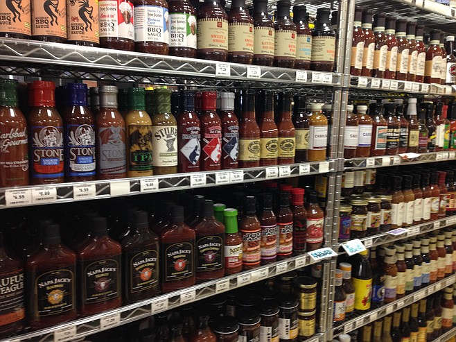 Racks filled with barbecue sauce to complement the main attractions