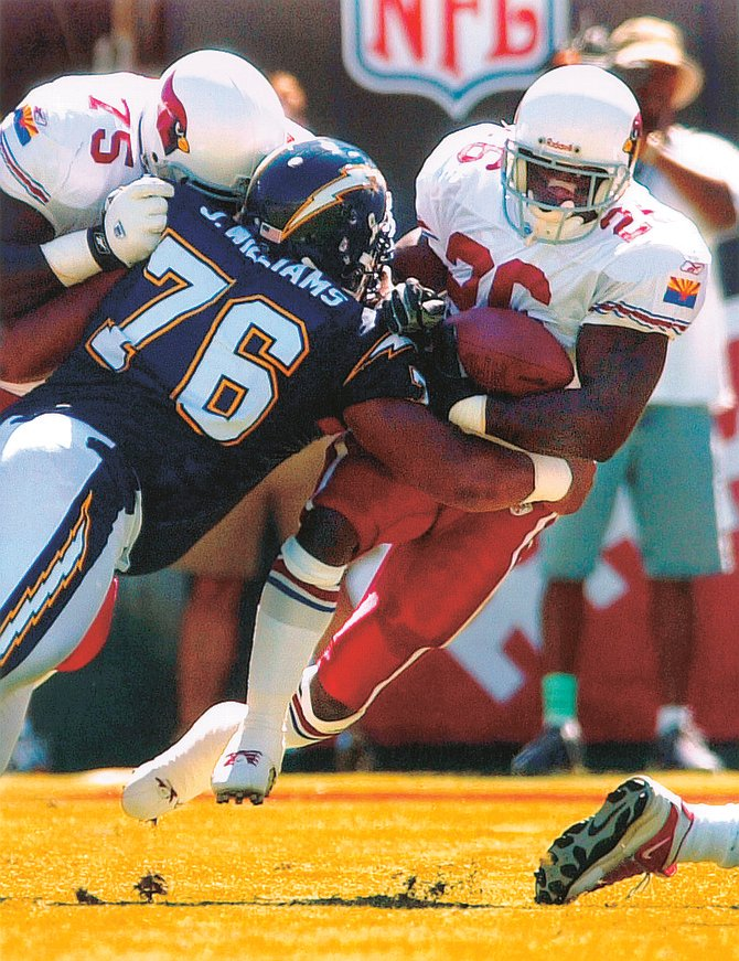 Jamal Williams (76) in Chargers – Cardinals game, 9/22/02. Sureldie Williams, wife  Jamal Williams, alleges her husband turned against her, striking out violently. Jamal was arrested at their daughter's La Jolla school,