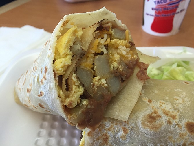 Breakfast burrito with scrambled egg, potato, cheese, and beans