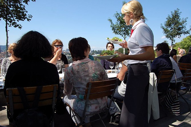 Outdoor dining during the late summer on the patio of Restaurant Rosengarten offers lovely vistas of Bern.