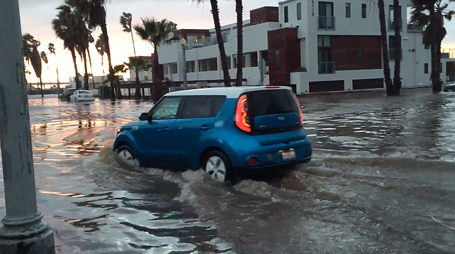 Notoriously flood-prone corner of Abbott and Saratoga