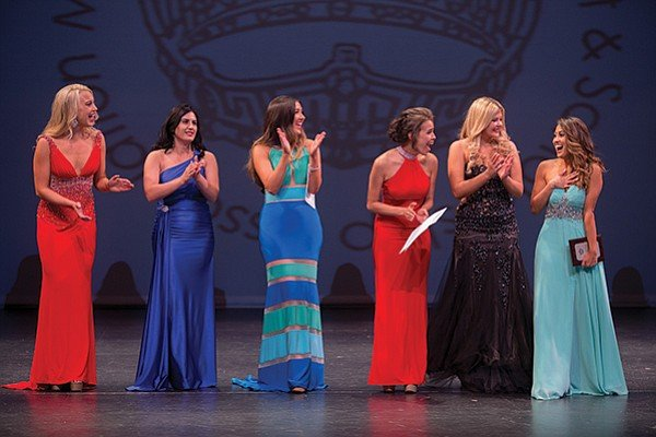Contestants clap as Chelsea Magracia (far right) is announced as Miss San Diego 2015.