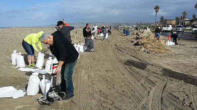 All hands on sandbag detail, January 6, 2015