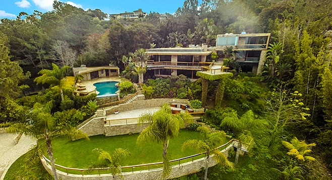 The La Jolla mansion and its multi-tiered backyard sit on the northwestern slope of Mt. Soledad.