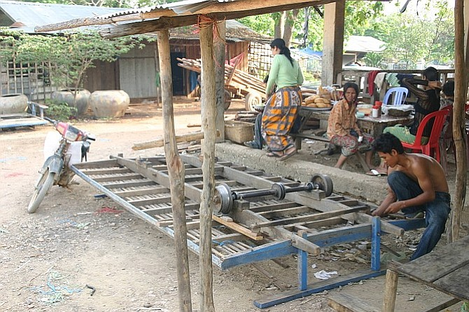 """Repairing a """"norry,"""" or bamboo train car."""