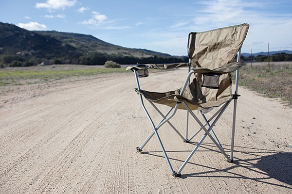 Alyce Copeland sat in a folding chair, blocking the road