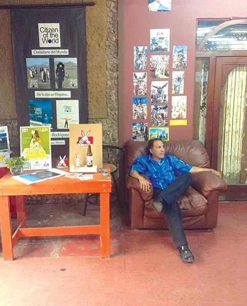 Victor Hugo sits next to Burrito Lindo program