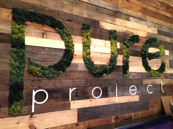 Pure Project's tasting room makes creative use of the living wall concept.