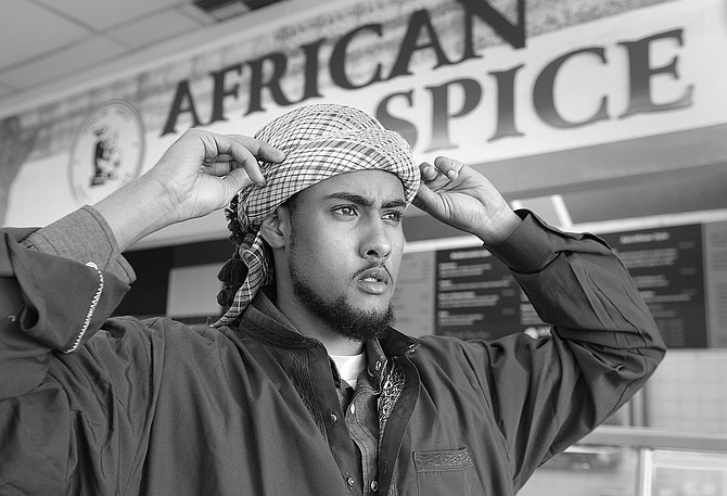 """Mohammed. """"Follow us,"""" says Mohammed. We walk down past the Waamo Wireless store to a little station where dozens of guys are taking their shoes off."""