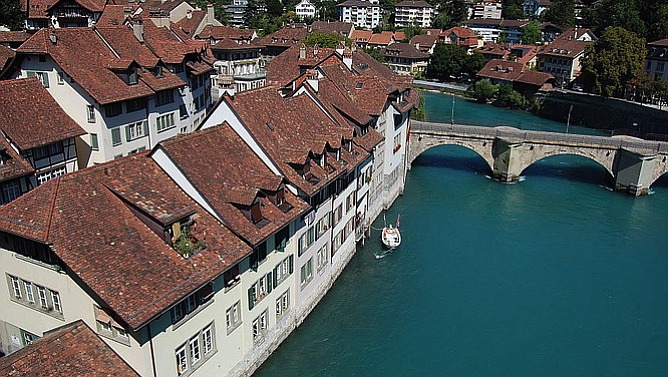 A view of the Aare and Bern's exquisite Old Town from the Nydeggbrücke bridge.