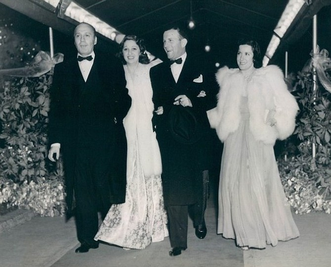 Jack Benny, Mary Livingston. George Burns, and Gracie Allen walk the red carpet. January 7, 1937.