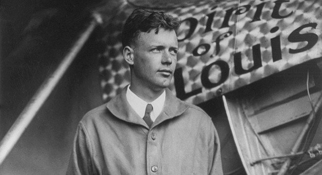 Charles Lindbergh and the plane in which he crossed the Atlantic in 1927