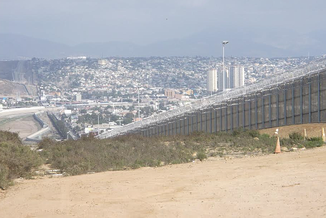 Razor wire installation began in September 2015 along the 16-foot tall secondary fence