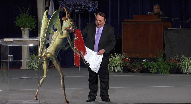 """Happier Times: Beelzebub presents Cerullo with a prayer shawl soaked in the Blood of the Worthless Poor at a 2014 Prosperity Gospel Conference. """"Back then, I thought we would go on and on,"""" recalls the disappointed demon. """"You can't see it in the photo, but my butt-face is smiling from cheek to cheek!"""""""