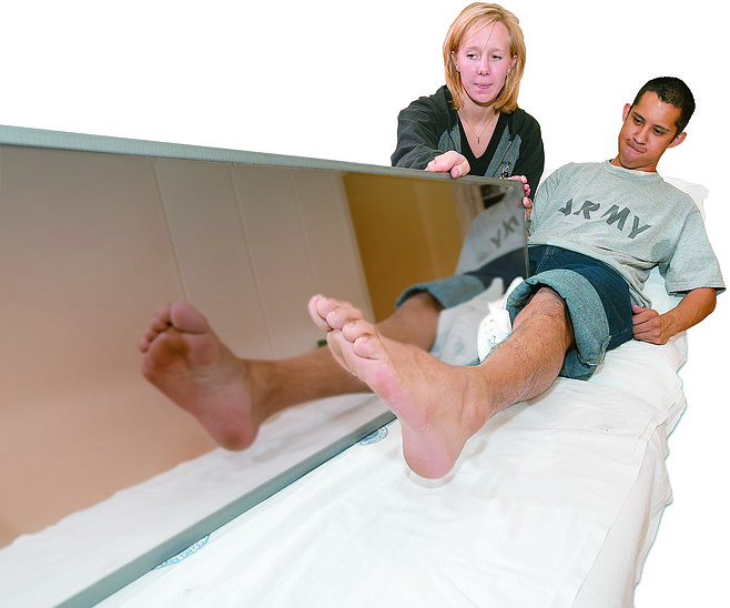 Leon Valent receives mirror therapy for phantom pain in his amputated right leg.