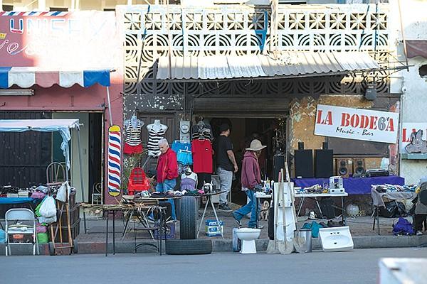Stolen and forgotten goods are sold on the street flea market.