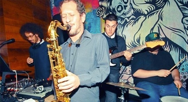 Gabriel Sundy honks his horn at Dizzy's Thursday night.