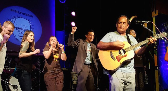 Jose Caballero (center) got down at the Worldbeat Center on January 30