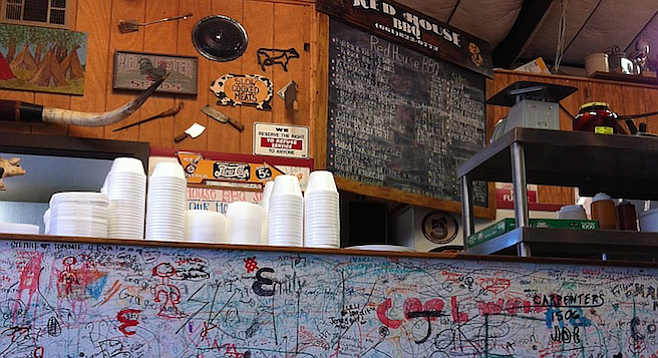Graffiti from past customers lines the counter wall at Tehachapi's Red House BBQ.
