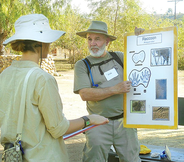 Tracking class instructor, Bob, shows how to identify raccoon tracks.