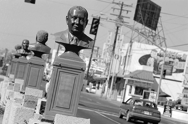 "Sixteen bronze busts of ""Tijuana's founders"" — businessmen, lawyers, politicians — stare westward down Boulevard Agua Caliente."