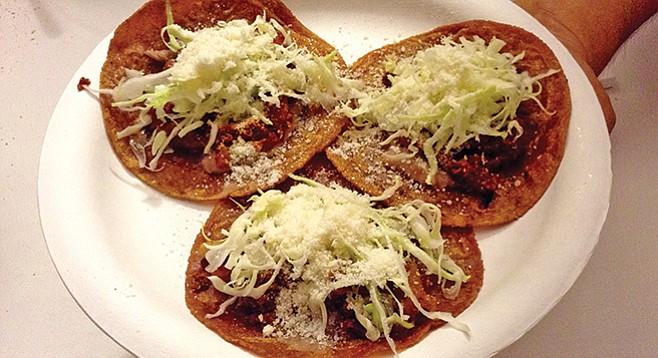 My three (orange) tacos: Pork, beef, soy, $8
