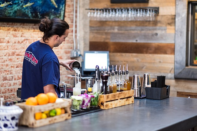 Bartender preparing a long drink