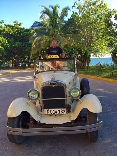 The author by the beach in a 1929 Ford.