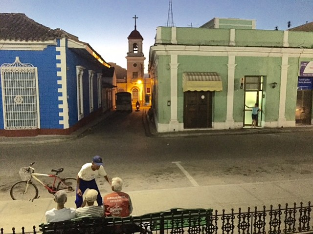 Locals gather on a Havana street. The city is relatively safe to walk at night.
