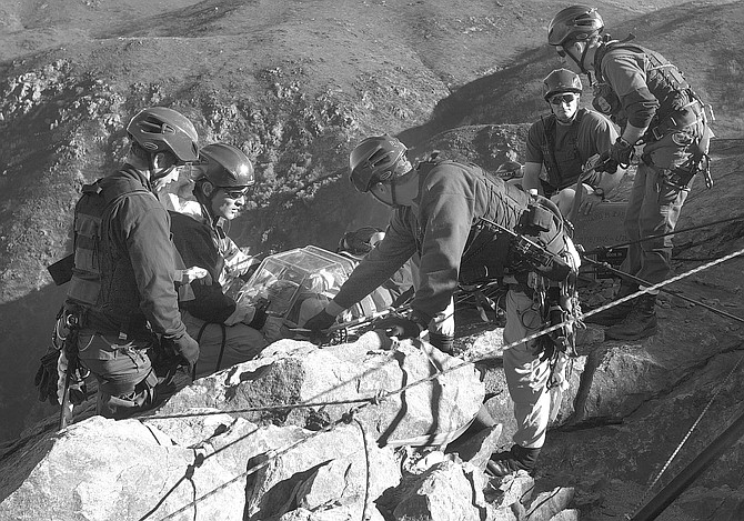 "BORSTAR team during cliff-rescue training in Laguna Mountains, 12/06/02. ""When we found the footprints and started following them, we kept noticing very small footprints."" - Image by Joe Klein"