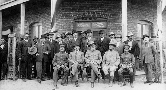 Raphael Courtney's great grandfather, Cesar Soriano, stands directly behind Mexican president Venustiano Carranza (front row with long white beard)