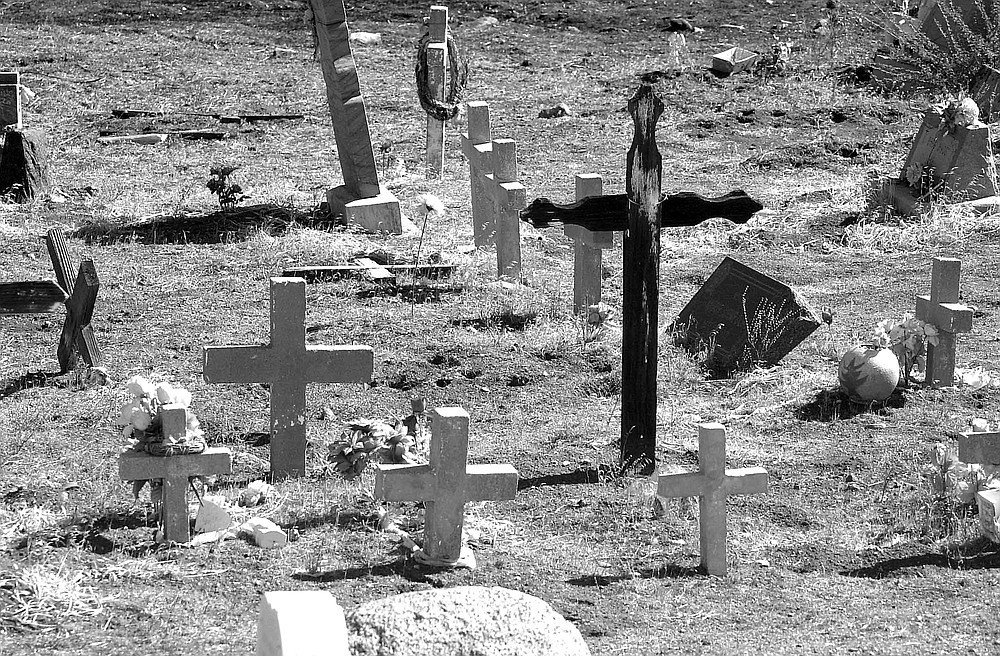 """Old Indian cemetery near the Keenans' cabin. """"A firefighter named Grand was glad to pay a visit to his relatives while he was here."""""""