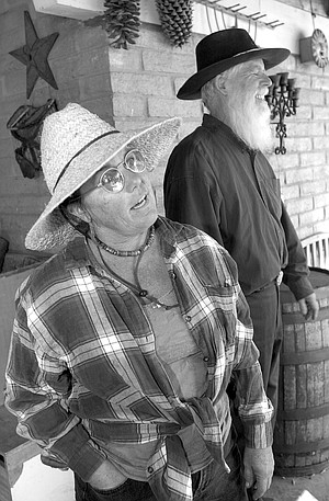 """Sally Snipes and Clint Powell. """"When we were evacuated, the only things I took were my computer and my piles of weather records."""""""